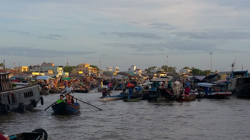 Image of floating market on the Mekong River in Vietnam.